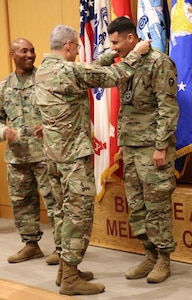 Sgt. Jorge Rodriguez, Brooke Army Medical Center, Warrior Transition Battalion, receives one gold, four silver and one bronze medal during a BAMC awards ceremony March 26. Rodriguez earned his medals participating in rowing, track, and swimming events at the 2019 Army Trials, hosted at Fort Bliss, Texas, March 5-16.