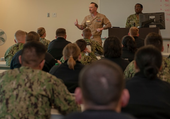 Chief Petty Officer Mark Francesco, an instructor with the Biomedical Technician program at the Medical Education and Training Campus at Joint Base San Antonio-Fort Sam Houston, speaks to students of the Hospital Corpsman Basic program about the Navy-Marine Corps Relief Society.