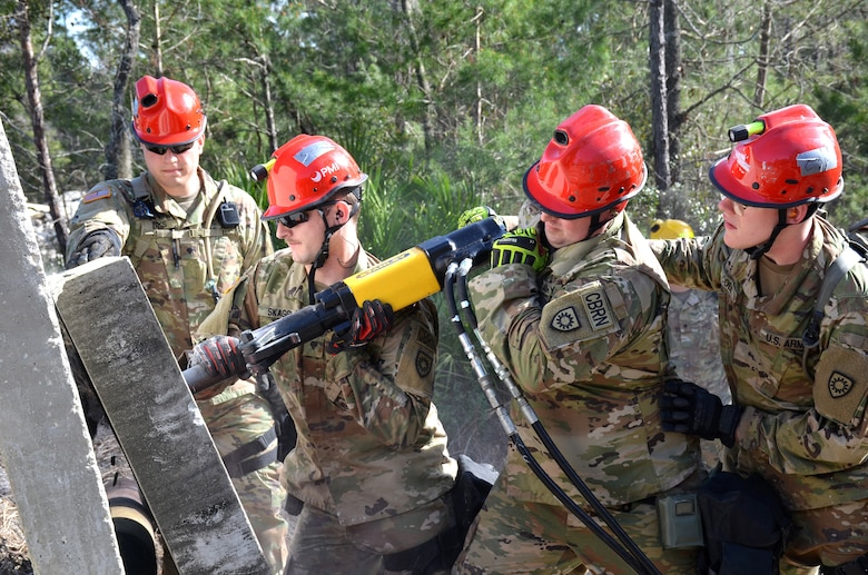 Soldiers with the Kentucky National Guard CBRNE Enhanced Response Force Package, or CERFP, use a hammer drill to extract a simulated victim from a rubble pile during an exercise evaluation at Camp Blanding, Fla., Jan. 10, 2019. The CERFP was tasked with responding to a 10-kiloton nuclear explosion, establishing a support zone, searching the hot zone for victims, extracting and decontaminating the victims, and providing medical assistance. (U.S. Army National Guard photo by Sgt. Taylor Tribble)
