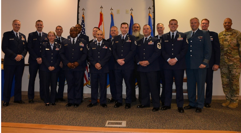 (Left) Lt. Gen. R. Scott Williams, Continental U.S. NORAD Region-1st Air Force (Air Forces Northern) Commander, joins a portion of 2018 CONR-1st AF (AFNORTH) Annual Award recipients who were able to make the trip to the ceremony at Tyndall Air Force Base, Fla., March 27. (U.S. Air Force photo by Mary McHale)