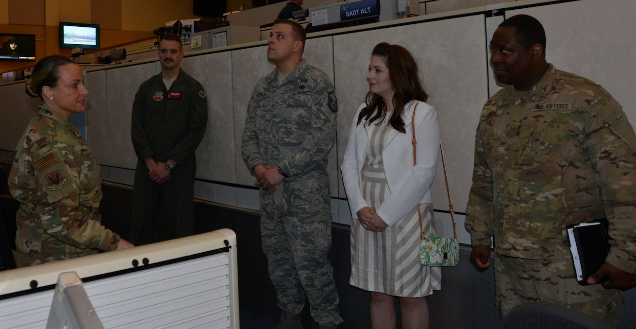 Chief Master Sgt. Karrie Bennett, 601st Chief Enlisted Manager, briefs some of the Continental U.S. Aerospace Defense Region 2018 annual award winners along with a spouse during a tour of the 601st Air Operations Center March 27. (U.S. Air Force photo by Mary McHale)
