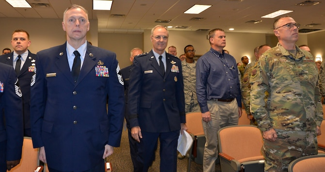 Attendees at the Continental U.S. NORAD Region-1st Air Force (Air Forces Northern) 2018 Annual Award Ceremony stand at attention as Lt. Gen. R. Scott Williams, CONR – 1 AF (AFNORTH) Commander, enters the auditorium to open the event. (U.S. Air Force photo by Mary McHale)