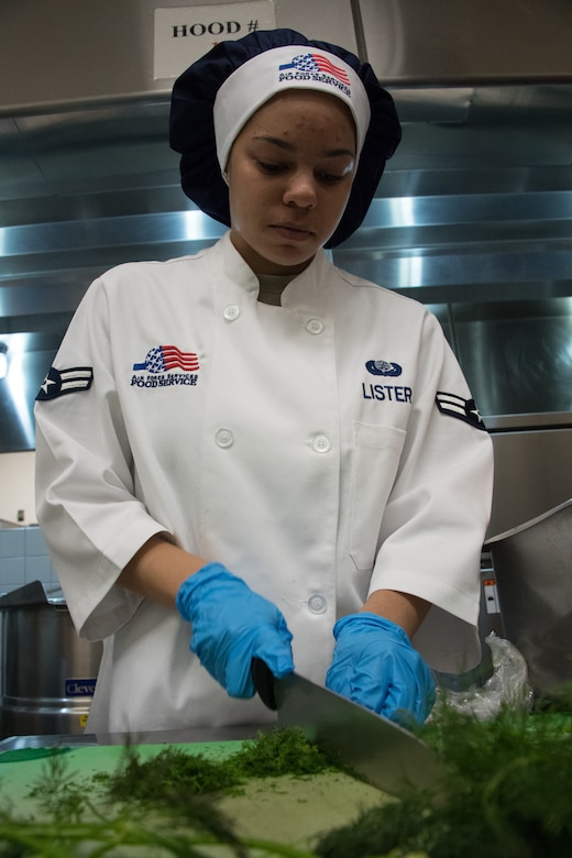 U.S. Air National Guardsman Airman 1st Class Arrianna Lister, 146th Airlift Wing Services Flight, prepares food to be served during an evaluation at the Channel Islands Air National Guard Station, Port Hueneme, Calif., Mar. 9, 2019. The 146th AW was selected out of 70 other wings for evaluation of kitchen operations for the possibility to win the Kenneth Disney award sponsored by the National Restaurant Association, the Culinary Institute of America and various hospitality industry sponsors for outstanding Air National Guard facilities with best dining operations nationally.  (U.S. Air National Guard photo by Tech. Sgt. Nieko Carzis.)