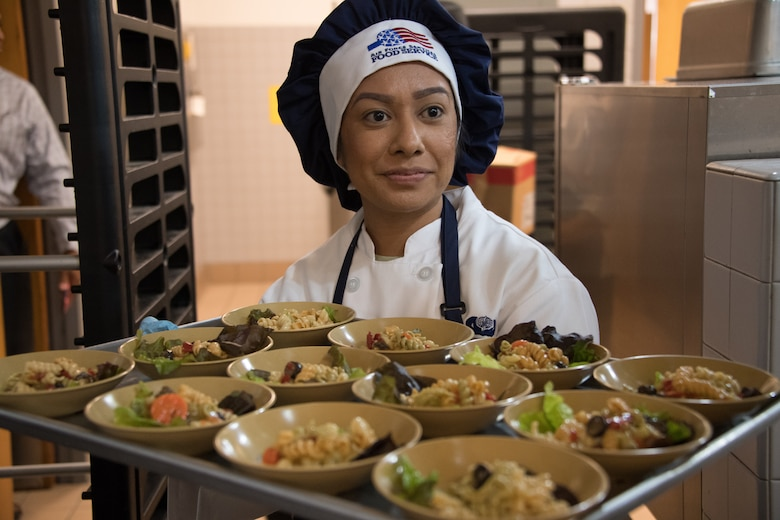 U.S. Air National Guardsman Airman 1st Class Gabriela Gutierrez from the 146th Airlift Wing Services Flight prepares food to be served during an evaluation at the Channel Islands Air National Guard Station, Port Hueneme, Calif., Mar. 9, 2019. The 146th Airlift Wing was selected out of 70 other wings for evaluation of kitchen operations for the possibility to win the Kenneth Disney award sponsored by the National Restaurant Association, the Culinary Institute of America and various hospitality industry sponsors for outstanding Air National Guard facilities with best dining operations nationally.  (U.S. Air National Guard photo by Tech. Sgt. Nieko Carzis.)