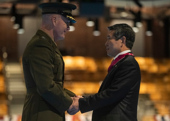 Marine Corps Gen. Joe Dunford, chairman of the Joint Chiefs of Staff, presents the Legion of Merit to Minister of National Defense of the Republic of Korea Jeong Kyeong-doo at Conmy Hall on Joint Base Myer-Henderson Hall, April 2, 2019.