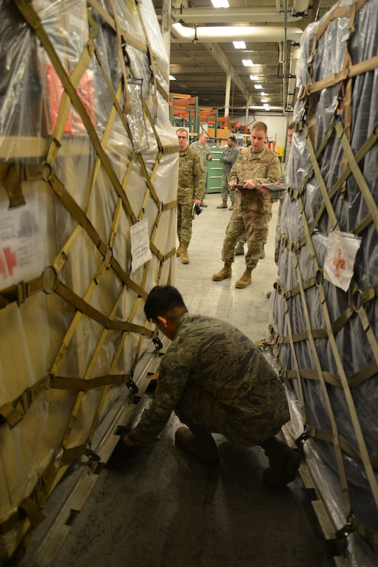 Airmen prepare to weigh medical cargo for a simulated deployment during Polar Force 19-4 at Joint Base Elmendorf-Richardson, Alaska, March 26, 2019. Polar Force is a two-week exercise designed to test JBER's mission readiness and develops the skills service members require to face adverse situations. The 773d Logistics Readiness Squadron, 673d Medical Support Squadron and 732d Air Mobility Squadron prepared medical cargo for a simulated deployment that included decontamination readiness materials, a stand-up mobile hospital and extra supplies for deployments.