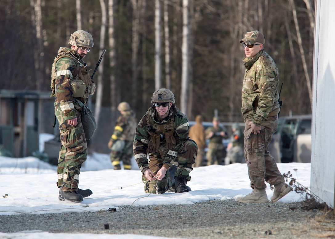 673d Civil Engineer Squadron Explosive Ordnance Disposal Airmen set-up remote pulls in a simulated chemical environment during Polar Force 19-4 at Joint Base Elmendorf-Richardson, Alaska, April 2, 2019. Polar Force is a two-week exercise designed to test JBER's mission readiness and strengthen and develop the skills service members require when facing adverse situations.