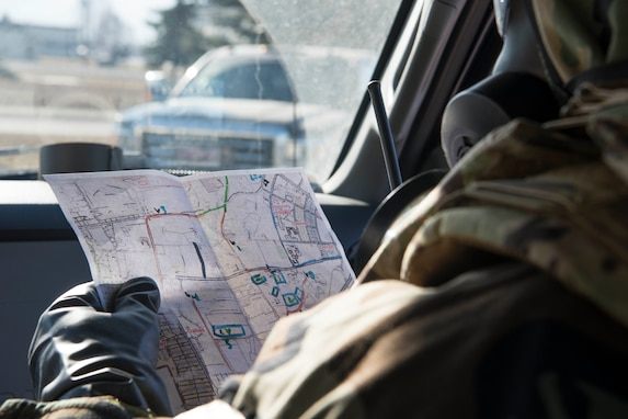 U.S. Air Force Staff Sgt. Garrett Broadwater, a 773d CES emergency management technician, looks at a perimeter map during exercise Polar Force 19-4 at Joint Base Elmendorf-Richardson, Alaska, April 3, 2019. The reconnaissance team assesses contamination, casualties, and damage, then reports their findings to the Emergency Operations Center. Polar Force is a two-week exercise designed to test JBER's mission readiness, and develops the skills service members require to face adverse situations.