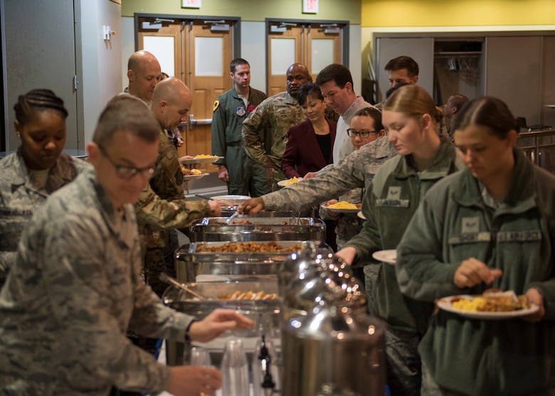 """Members of Team Osan gather for breakfast at the kickoff and signing of the proclamation of Sexual Assault Awareness and Prevention Month at Osan Air Base, Republic of Korea, April 3, 2019. The month of April marks Sexual Assault Awareness and Prevention Month (SAAPM), and this year's theme of """"Protecting our people protects our mission,"""" epitomizes the military's efforts. (U.S. Air Force photo by Staff Sgt. Ramon A. Adelan)"""