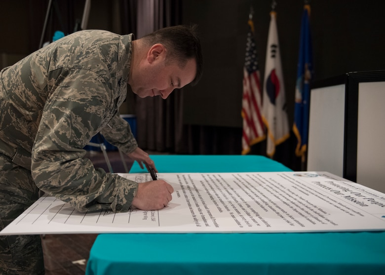 U.S. Air Force Col. William Betts, commander of the 51st Fighter Wing, signs a proclamation for the kickoff of Sexual Assault Awareness and Prevention Month at Osan Air Base, Republic of Korea, April 3, 2019. By signing the proclamation, Betts pledged Team Osan's commitment to make every effort to reduce and eliminate sexual assaults here and across the Air Force. (U.S. Air Force photo by Staff Sgt. Ramon A. Adelan)