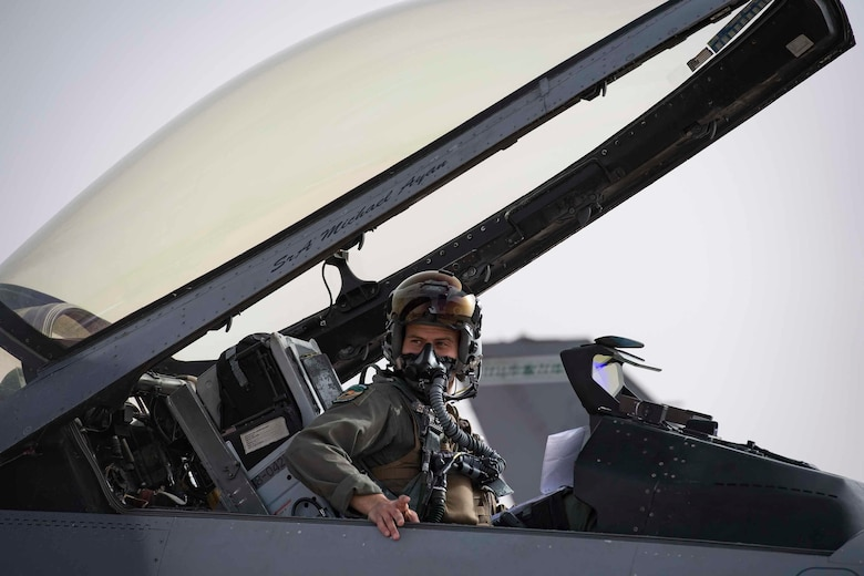 U.S. Air Force 1st Lt. Quincey Watts, a 555th Expeditionary Fighter Squadron F-16C Fighting Falcon pilot, exits his aircraft during exercise African Lion 2019 at Ben Guerir Air Base, Morocco, March 25, 2019.