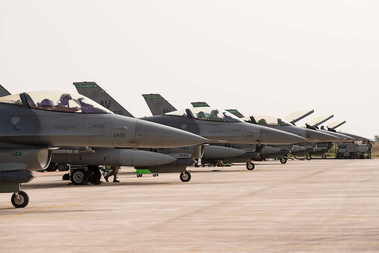 F-16C Fighting Falcons from the 555th Expeditionary Fighter Squadron rest on the flight line during exercise African Lion 2019 at Ben Guerir Air Base, Morocco.