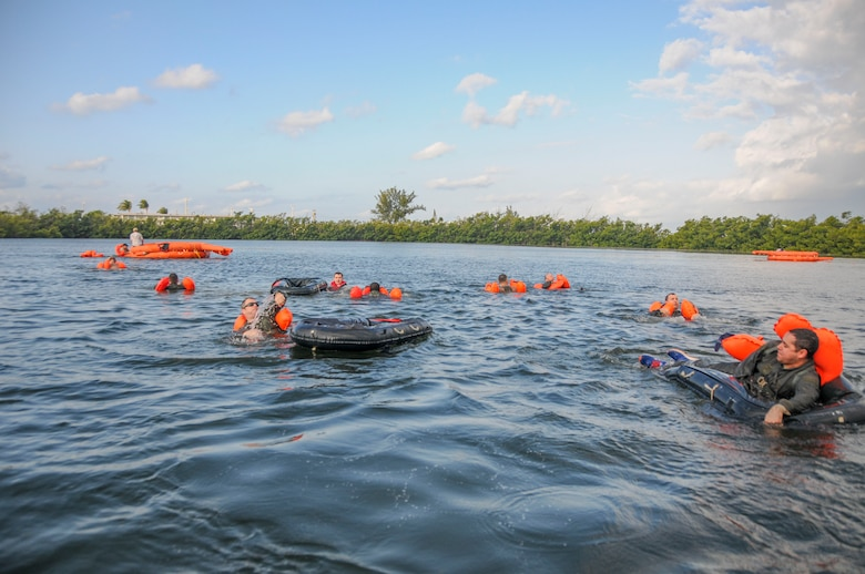 Members of the 94th Operations Group participate in Water Survival Training at Naval Air Station Key West, Florida March 27, 2019. The two-day Survival, Evasion, Resistance and Escape course prepared aircrew, aeromedical and aircraft flight equipment personnel how to deal with emergencies on water and land. (U.S. Air Force photo/Senior Airman Justin Clayvon)