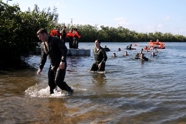 Members of the 94th Operations Group complete Water Survival Training at Naval Air Station Key West, Florida March 27, 2019. The two-day Survival, Evasion, Resistance and Escape course prepared aircrew, aeromedical and aircraft flight equipment personnel how to deal with emergencies on water and land. (U.S. Air Force photo/Senior Airman Justin Clayvon)
