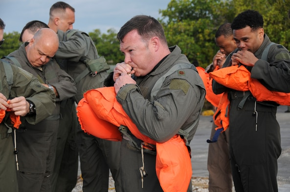 Members of the 94th Operations Group inflate flotation devices during Water Survival Training at Naval Air Station Key West, Florida March 27, 2019. During the two-day Survival, Evasion, Resistance and Escape course, members also completed Self Aid Buddy Care and combat survival. (U.S. Air Force photo/Senior Airman Justin Clayvon)