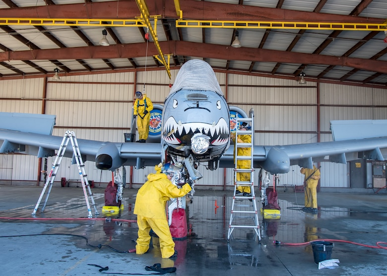 Airmen from the 23d Maintenance Group wash an A-10C Thunderbolt II, Feb. 25, 2019, at Moody Air Force Base, Ga. On top of their daily scheduled maintenance a team of six Airmen dedicated over 10 hours washing the A-10 to ensure the aircraft was free of any surface or structural deficiencies that could present a safety hazard during flight. (U.S. Air Force photo by Airman 1st Class Eugene Oliver)