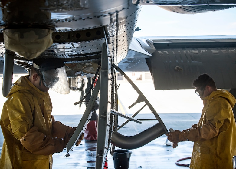 Airman 1st Class Eric Foster, left, and Airman 1st Class Hector Ramirez-Borbon, 74th Aircraft Maintenance Unit crew chiefs, clean components of an A-10C Thunderbolt II, Feb. 25, 2019, at Moody Air Force, Ga. To guarantee Moody's fleet of 49 A-10s are in peak warfighting condition, Airmen from the 23d Maintenance Group dedicated over 10 hours washing an A-10 to ensure the aircraft is free of any surface or structural deficiencies that could present a safety hazard during flight. (U.S. Air Force photo by Airman 1st Class Eugene Oliver)