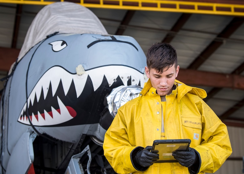 Airman 1st Class Benjamin Jones, 74th Aircraft Maintenance Unit crew chief, reads a technical order, Feb. 25, 2019, at Moody Air Force Base, Ga. To guarantee Moody's fleet of 49 A-10C Thunderbolt II's are in peak warfighting condition, Airmen from the 23d Maintenance Group dedicated over 10 hours washing the A-10 to ensure the aircraft is free of any surface or structural deficiencies that could present a safety hazard during flight. (U.S. Air Force photo by Airman 1st Class Eugene Oliver)