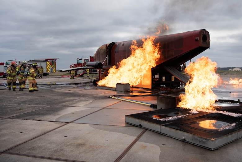 U.S. Air Force Airmen assigned to the 52nd Civil Engineer Squadron Fire Department conduct live-fire aircraft burn training at Spangdahlem Air Base, Germany, March 26, 2019. Live-fire exercises help firefighters learn how to extinguish engine or fuel pool fires. (U.S. Air Force photo by Airman 1st Class Valerie Seelye)