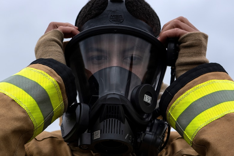 Omar Moylan, a senior at Spangdahlem High School, dons fire-protection gear at Spangdahlem Air Base, Germany, March 26, 2019. Moylan, who plans to enlist in the U.S. Air Force as a firefighter, participated in exercises with the 52nd Civil Engineer Squadron Fire Department as part of the school's Career Practicum program. (U.S. Air Force photo by Airman 1st Class Valerie Seelye)