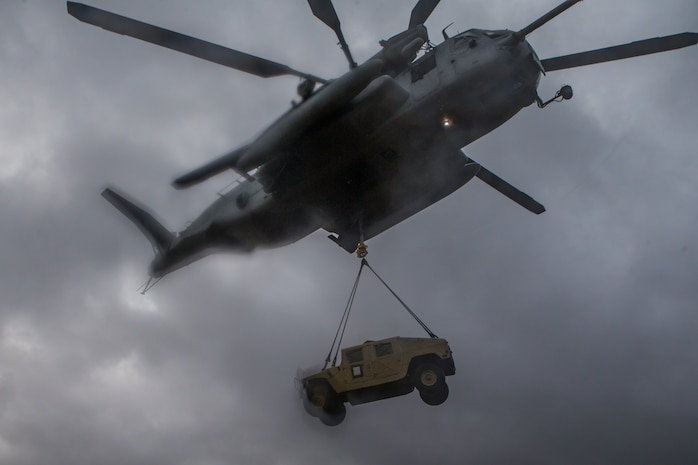 A CH-53E Super Stallion with Marine Heavy Helicopter Squadron 464, Marine Air Group 29, 2nd Marine Air Wing, lifts a Humvee with during a tactical recovery of aircraft and personnel training event with 2nd Transportation Support Battalion, Combat Logistics Regiment 2, 2nd Marine Logistics Group at Camp Lejeune, North Carolina, April 2, 2019. 2nd TSB held the training to maintain proficiency in day-to-night-external lifts.