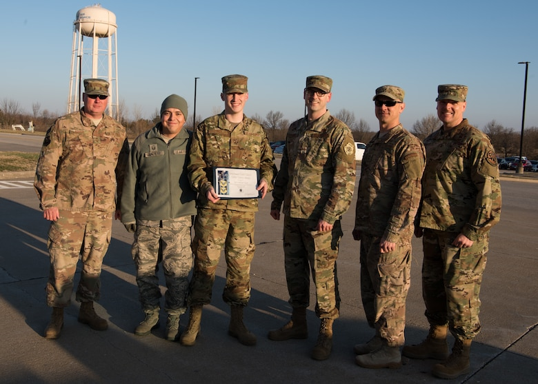 Senior Airman Dillon Lund, a low observable journeyman with the 509th Maintenance Squadron poses for a group photo after receiving the Chief's Choice Award for February 2019.