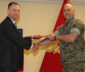 Marine retires after 22 years of service to Corps, nation CWO3 Geoffrey A. Collver, financial management resource officer, G8, Marine Corps Logistics Command, retired after serving 22 years in the Marine Corps during a ceremony held in Building 3700, April 2.