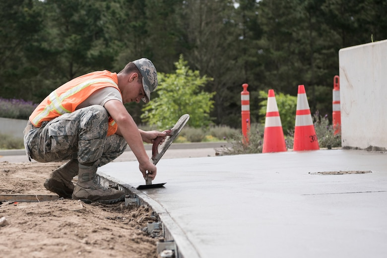 Airman 1st Class Devin Bergeron, 30th Civil Engineering Squadron Airman, lays concrete April 3, 2019, on Vandenberg Air Force Base, Calif. Bergeron helps maintain Vandenberg AFB along with making repairs and upgrades when needed. (U.S. Air Force photo by Airman 1st Class Hanah Abercrombie)