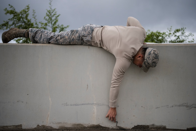 Senior Airman Noah Matsuura, 30th Civil Engineering Squadron Airman, evens out wet concrete April 3, 2019, at Vandenberg Air Force Base, Calif. Matsuura helps maintain Vandenberg AFB and provide repairs and upgrades when needed. (U.S. Air Force photo by Airman 1st Class Hanah Abercrombie)