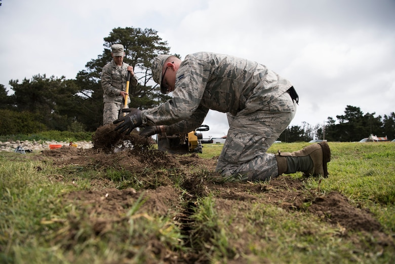 Airman 1st Class Tristan Gibson, 30th Civil Engineering Squadron Airman, participates in base repairs April 4, 2019, on Vandenberg Air Force Base, Calif. Gibson helps maintain Vandenberg AFB and makes repairs and upgrades when needed. (U.S. Air Force photo by Airman 1st Class Hanah Abercrombie)
