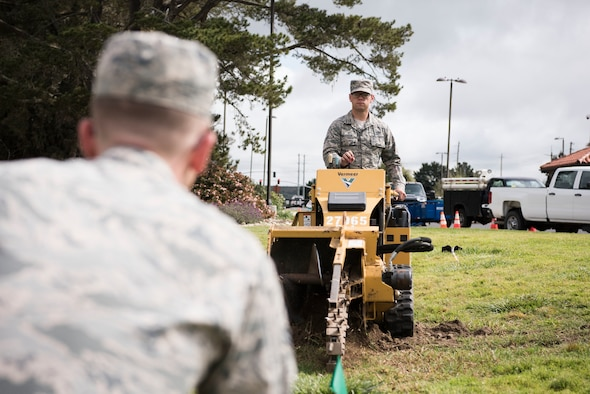 Airman 1st Class Rafael Waledziak, 30th Civil Engineering Squadron, operates machinery during base repairs April 3, 2019, on Vandenberg Air Force Base, Calif. Waledziak helps maintain Vandenberg AFB along with making repairs when needed. (U.S. Air Force photo by Airman 1st Class Hanah Abercrombie)