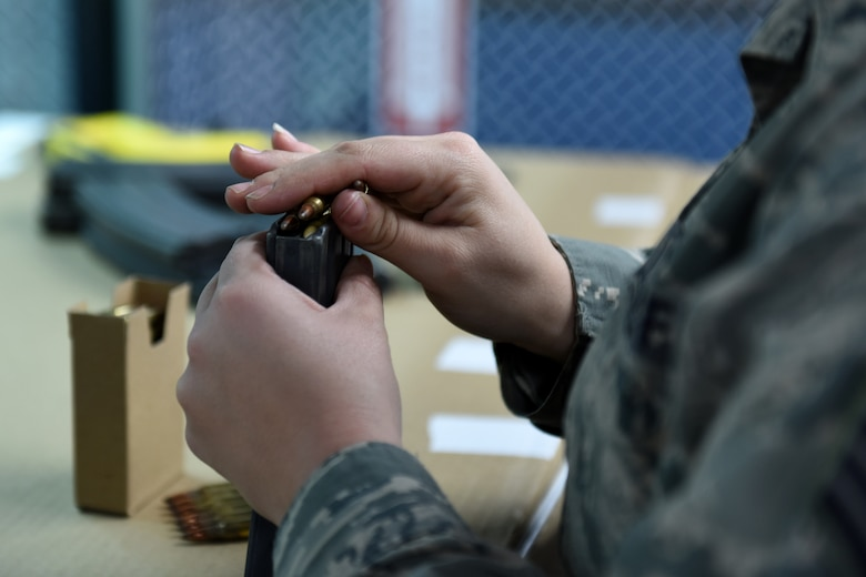 Staff Sgt. Jess Thebeau, munitions systems technician assigned to the 180th Fighter Wing, Ohio Air National Guard, loads ammunition during the first weapons qualification class in the new Modular Small Arms Range in Swanton. Ohio, Nov. 30, 2018. The high-tech facility is climate-controlled, has high efficiency air handlers, bullet traps and multiple simulation options that promotes safety, while providing scenario-based shooting situations for personnel to train and meet readiness requirements. (Air National Guard Photo by Senior Airman Hope Geiger)