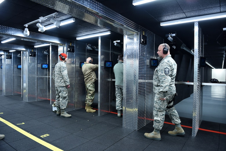 Airmen assigned to the 180th Fighter Wing, Ohio Air National Guard, take the first shots after the official opening of the Modular Small Arms Range in Swanton, Ohio, Nov. 30, 2018. The high-tech facility is climate-controlled, has high efficiency air handlers, bullet traps and multiple simulation options that promotes safety, while providing scenario-based shooting situations for personnel to train and meet readiness requirements. (Air National Guard Photo by Senior Airman Hope Geiger)