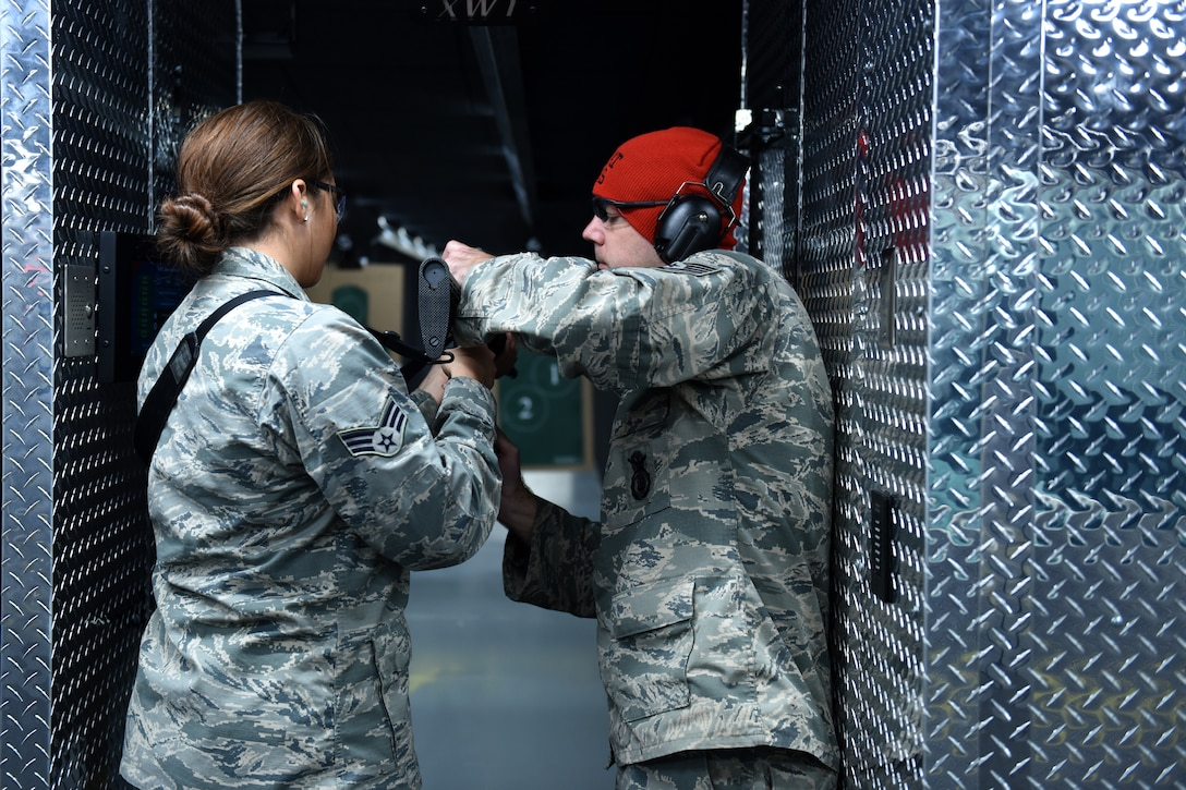 Tech Sgt. Jasen Jazwiecki, a security forces squadron member and combat arms training maintenance instructor, instructs SrA Conner Phillips, Munitions systems technician, both assigned to the 180th Fighter Wing, Ohio Air National Guard, during the first weapons qualification class in the new Modular Small Arms Range in Swanton, Ohio, Nov. 30, 2018. The MSAR is used for weapons qualification providing the ability to conduct individual or mass weapons qualification, on site, in a single day minimizing the need to rent out a different location. (Air National Guard Photo by Senior Airman Hope Geiger)