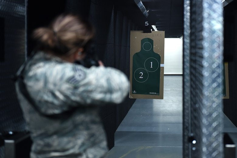 Staff Sgt. Jess Thebeau, munitions systems technician, assigned to the 180th Fighter Wing, Ohio Air National Guard, lines her shot up to the target during the first weapons qualification class in the new Modular Small Arms Range in Swanton, Ohio, Nov. 30, 2018. The high-tech facility is climate-controlled, has high efficiency air handlers, bullet traps and multiple simulation options that promotes safety, while providing scenario-based shooting situations for personnel to train and meet readiness requirements. (Air National Guard Photo by Senior Airman Hope Geiger)