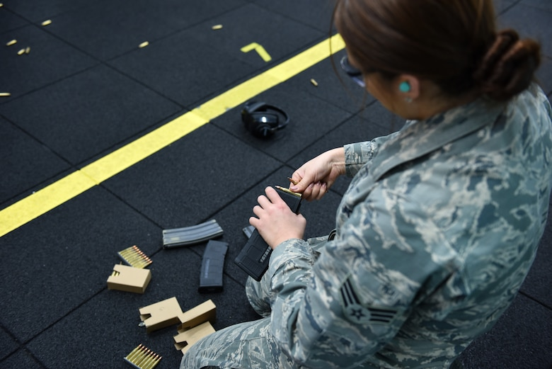 Senior Airman Conner Phillips, a munitions systems technician assigned to the 180th Fighter Wing, Ohio Air National Guard, loads ammunition during the first weapons qualification class in the new Modular Small Arms Range in Swanton. Ohio, Nov. 30, 2018. The high-tech facility is climate-controlled, has high efficiency air handlers, bullet traps and multiple simulation options that will promote safety, while providing scenario-based shooting situations for personnel to train and meet readiness requirements. (Air National Guard Photo by Senior Airman Hope Geiger)