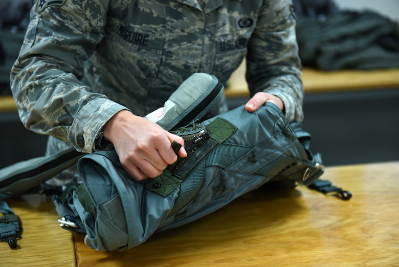 Senior Airman Abbie McGuire, an aircrew flight equipment technician assigned to the 180th Fighter Wing, Ohio Air National Guard, prepares flight equipment before the days training sorties at Patrick Air Force Base Florida, Jan. 28, 2019. It is aircrew flight equipment's responsibility to maintain, build, and inspect all the equipment a pilot wears or needs while flying a jet such as flight helmets, oxygen masks, parachutes, survival kits, floatation devices, aircrew night vision, flight suits and harnesses. (Air National Guard photo by Senior Airman Hope Geiger)