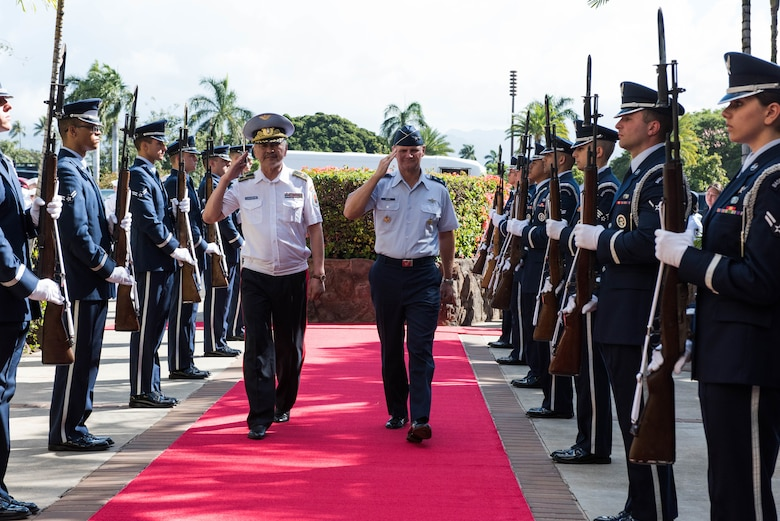 Commander of the Mongolian Air Force Command Brig. Gen. Enkhbayar Ochir and Pacific Air Forces Deputy Commander Maj. Gen. Russ Mack salute as they pass through the honor cordon at Headquarters PACAF, Joint Base Pearl Harbor-Hickam, Hawaii, March 26, 2019.