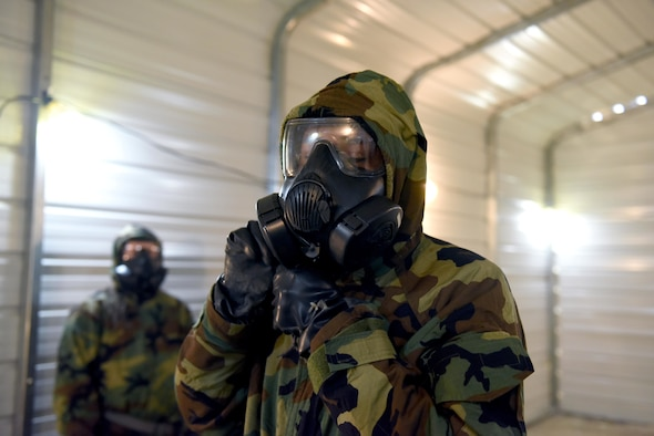 Staff Sgt. Kyaries Williams, 14th Security Forces Squadron, begins to take off his gas mask in the chamber, March 28, 2019, on Columbus Air Force Base, Miss. The Blaze Arena is the newest addition to Columbus Air Force Bases facilities in preparation for Airmen readiness. (U.S. Air Force photo by Senior Airman Beaux Hebert)
