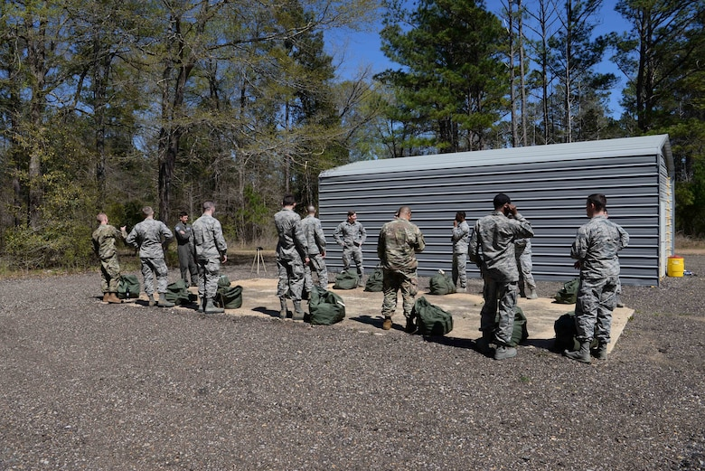 The first class for the Blaze Arena gas mask confidence chamber stands outside their bagged up gear, March 28, 2019, on Columbus Air Force Base, Miss. The 14th Civil Engineering Squadron worked the Blaze Arena operation for over a year and are one of two Air Education and Training Command bases with a gas mask confidence chamber. (U.S. Air Force photo by Airman 1st Class Jake Jacobsen)