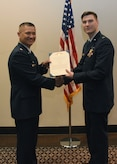 2nd Lt. Jordan Weum, 315th Training Squadron student, receives The Air Force Commendation Medal at his technical school graduation from Lt. Col. Mark Chang, 315th TRS commander at the Event Center on Goodfellow Air Force Base, Texas, April 4, 2019. The Air Force Commendation Medal is a military decoration which is awarded to an individual who demonstrates courage. (U.S. Air Force photo by Airman 1st Class Abbey Rieves/Released)