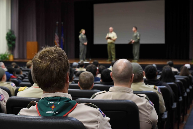 Scouts, Boy Scouts of America watch as their leadership present plaques to Col. Samantha Weeks, 14th Flying Training Wing commander, and Lt. Col. John Macasek, 49th Fighter Training Squadron commander, March 30, 2019, on Columbus Air Force Base, Mississippi. Scouts from the local area came to Columbus AFB and were able to learn about the flying training mission from 14th FTW Airmen. (U.S. Air Force photo by Airman 1st Class Keith Holcomb)