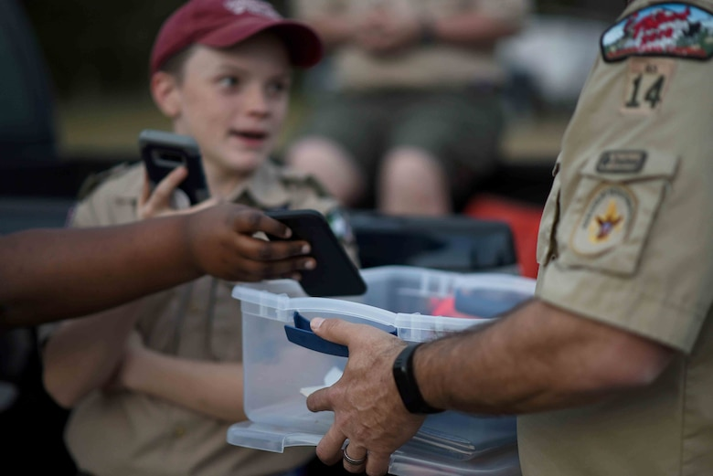Scouts, Boy Scouts of America members give their phones to their troop leader March 29, 2019, on Columbus Air Force Base, Mississippi. Roughly 150 scouts were able to participate in the overnight camping event on Columbus AFB. (U.S. Air Force photo by Airman 1st Class Keith Holcomb)