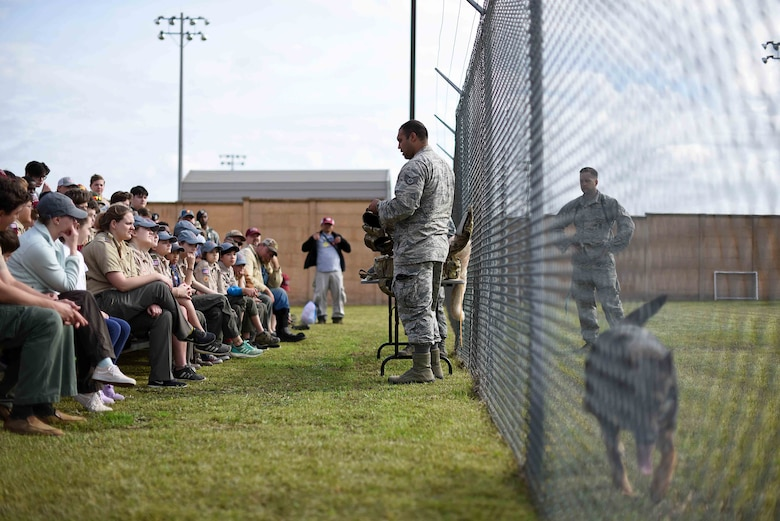Scouts, Boy Scouts of America members and their parents watch a 14th Security Forces Squadron military working dog demonstration March 30, 2019, on Columbus Air Force Base, Mississippi. The scouts also saw static aircraft, firefighters, air traffic controllers and aerospace and operational physiology flight Airmen in their work facilities. (U.S. Air Force photo by Airman 1st Class Keith Holcomb)