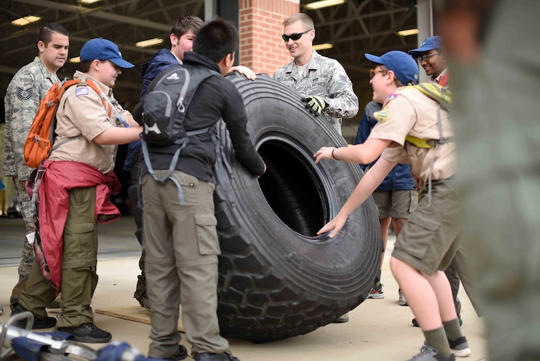 Scouts, Boy Scouts of America members try to push a tire with 14th Civil Engineer Squadron firefighters March 30, 2019, on Columbus Air Force Base, Mississippi. There were many hands-on activities to teach scouts of all ages what different careers in the Air Force do. (U.S. Air Force photo by Airman 1st Class Keith Holcomb)