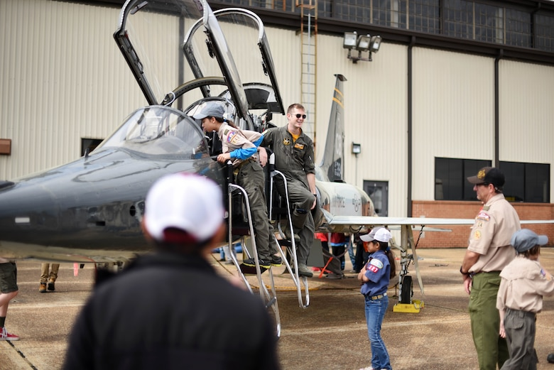Scouts, Boy Scouts of America members look inside a T-38C Talon March 30, 2019, on Columbus Air Force Base, Mississippi. The scouts were able to see each training airframe the 14th Flying Training Wing uses to create the next generation of military aviators. (U.S. Air Force photo by Airman 1st Class Keith Holcomb)