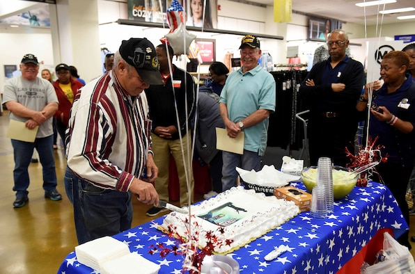 James Hardy, retired Army sergeant first class, cuts a cake during the 50th Vietnam Memorial Pinning Ceremony March 29, 2019, on Columbus Air Force Base, Miss. The ceremony, hosted by the Columbus AFB Base Exchange and Commissary, was in honor of the veterans and the 50th anniversary of the Vietnam War. (U.S. Air Force photo by Senior Airman Beaux Hebert)