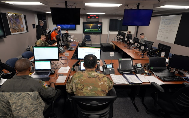 The 55th Wing's Recovery Operations Center staff works 16-hour shifts disseminating pertinent information to the base populous regarding the flooding caused by the Missouri River on March 19, 2019. The Missouri River breached the levee system which widened the river's footprint - covering one third of the base. (U.S. Air Force Photo by Josh Plueger)