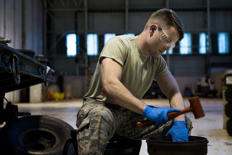 Airman 1st Class Jerrick Worley, 2nd Munitions Squadron munitions systems equipment maintenance crew chief, sets a seal into a hub at RAF Fairford, England, April 2, 2019. Since being at Fairford, 2nd MUNS Airmen like Worley have been able to work toward restoring the collection of munitions support equipment on Fairford. (U.S. Air Force photo by Airman 1st Class Tessa B. Corrick)