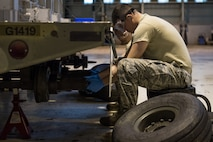 Airman 1st Class Landon Gonzales, 2nd Munitions Squadron conventional maintenance crew chief, replaces a hub on a MHU-110 munitions trailer during a U.S. Strategic Command Bomber Task Force in Europe at RAF Fairford, England, April 2, 2019. The 2nd MUNS brought Airmen for their primary duties and extra Airmen for the additional jobs such as the trailer maintenance. (U.S. Air Force photo by Airman 1st Class Tessa B. Corrick)